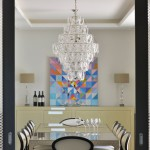 24 - Dining Room with glass chandelier and geometric-patterned film on the sliding glass doors