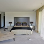 37 - The bedroom also features mirrored bedside tables and desk, plus a chaise longue